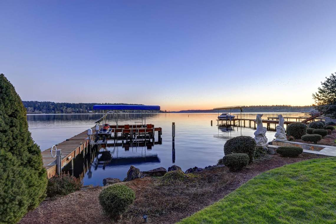 Private dock with jet ski lifts and covered boat lift, Lake Washington.